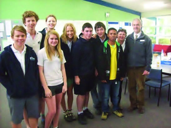 Catching up with old friends at Mansfield Secondary College. Joni 'guided' these students when they visited Venilale in 2011 and 2013. The students from left are: Travis Dyball, Arran Scale, Kayla Blaylock, Sian Scale, Ellen Watts, Jack Clark and Jordan Wilson. Also pictured with Joni is the supervising teacher for these trips, Julie Aldous, and the principal, Tim Hall, who continues to support the sister school relationship with Bercoli Junior High in Venilale.