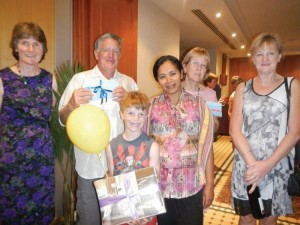Delighted winners of the raffles and lucky door prizes