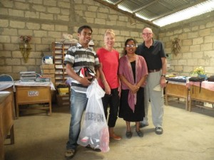 Handing over soccer and basketballs donated by Mansfield Apex