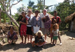 Visiting the home of one of the orphans to buy hand woven and organically dyed tais